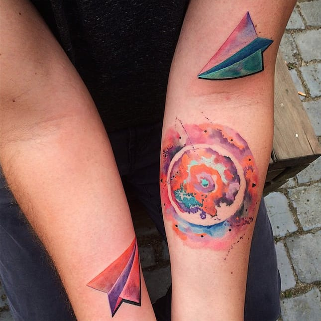 Nice colors on these Paper Plane Tattoos by Ondrash.
