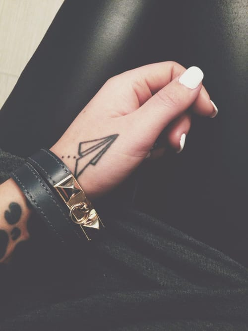 This would be a great place to get a small and subtle paper plane tattoo... on the hand that flies it!