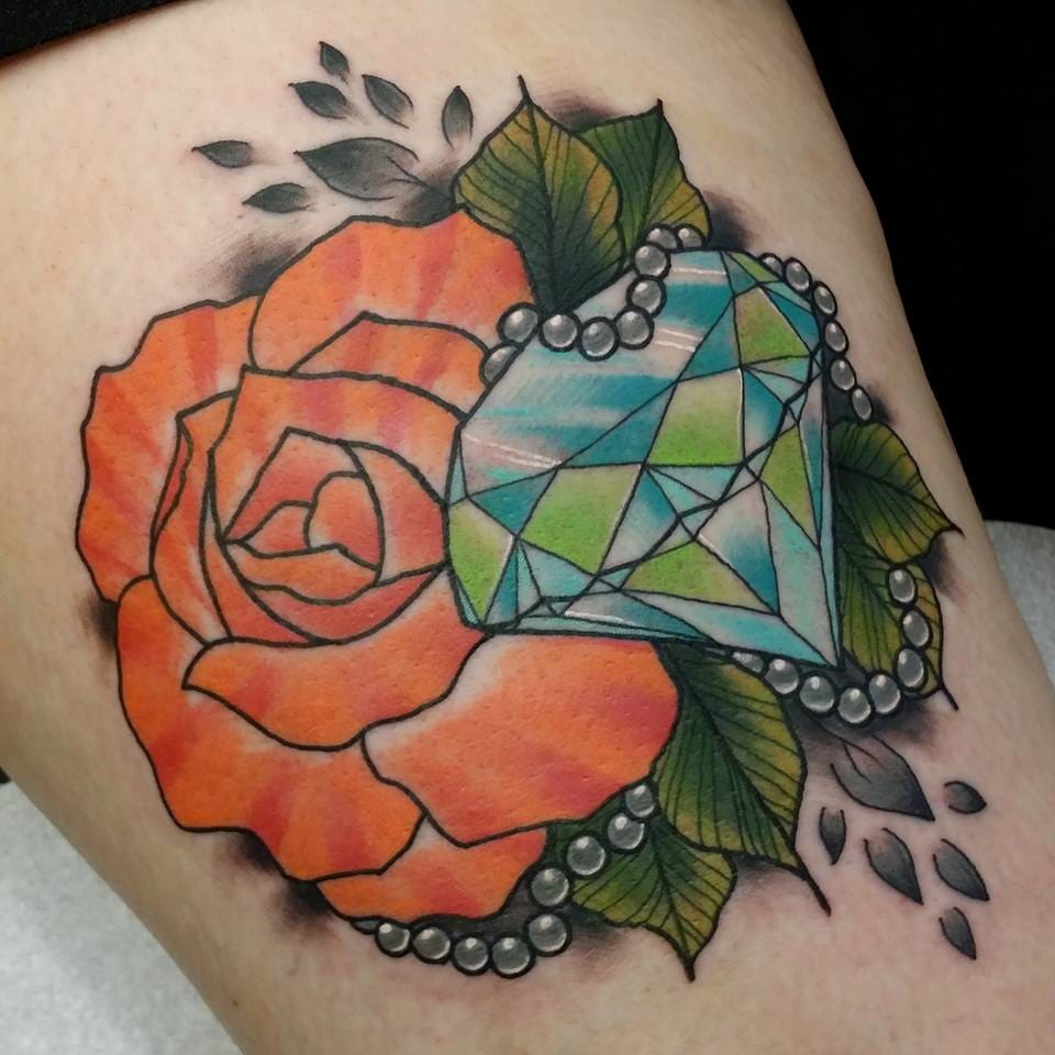 Rose tattoo by Paula Castle.