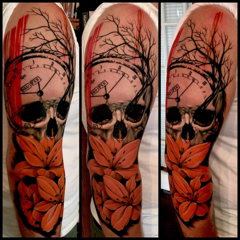 Multiple imagery in this colour sleeve tattoo.