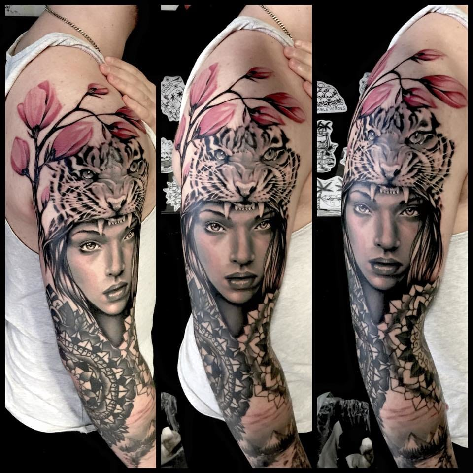 Mandalas, realism, black and grey and colour, all in one magnificent tattoo.