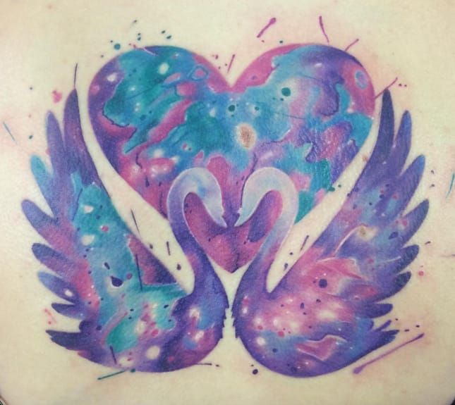 Beautiful symmetrical pastel tattoo by Emma Kerr.