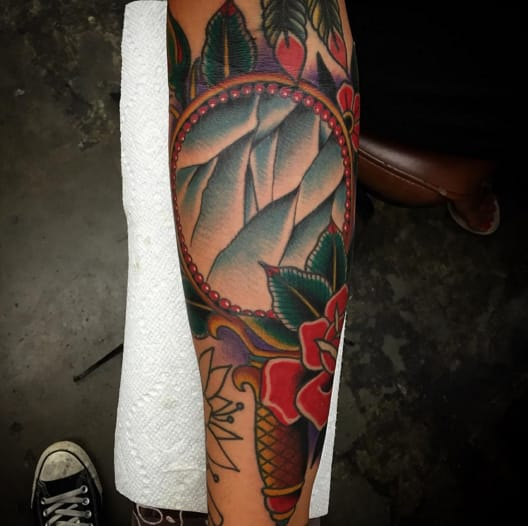 Traditional mirror tattoo by Josh Persons.
