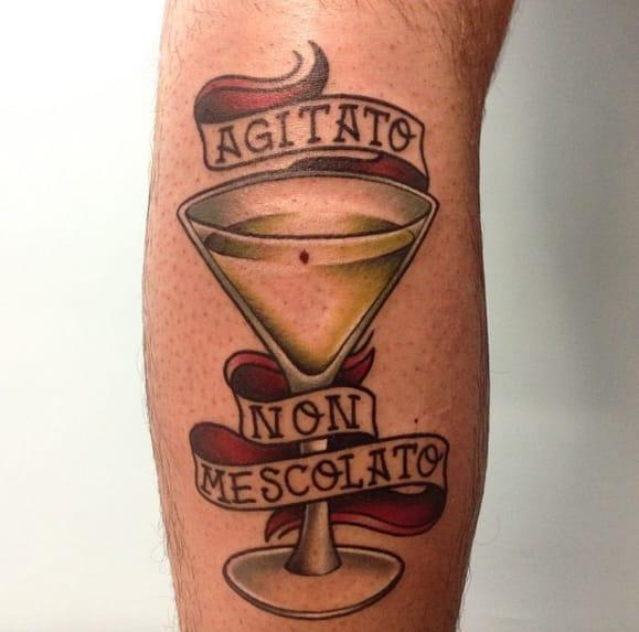 Martini. Shaken, not stirred. Tattoo by Fede Perla Madonna.