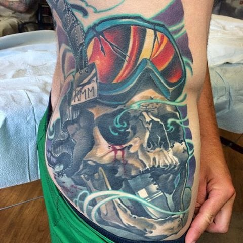 Snowboard and skull tattoo by Damian Robertson