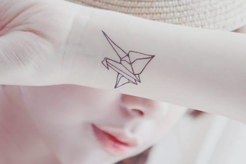 Minimalistic wrist tattoo by Dr Woo.