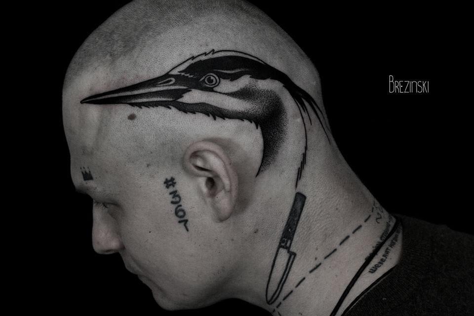 Bold heron head piece.