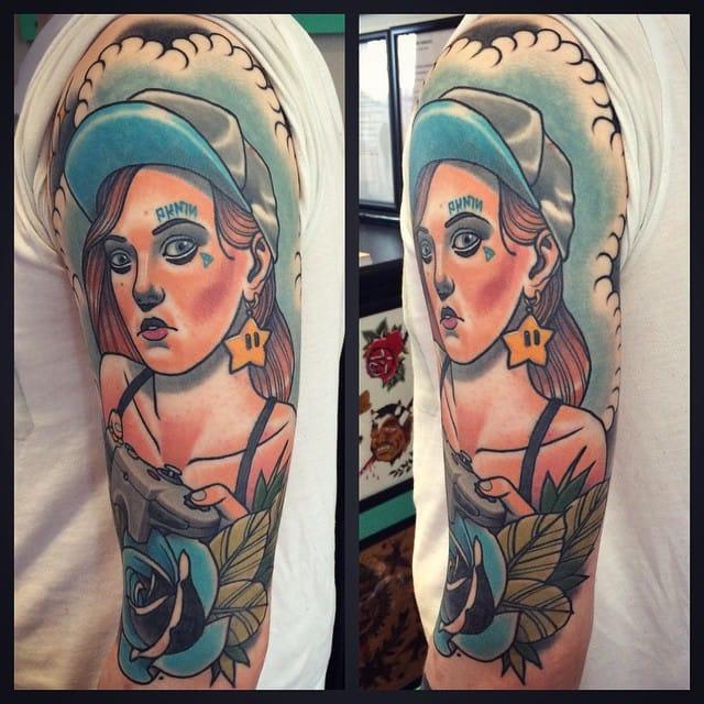 Lovely gamer girl tattoo by Jack Goks Pearce!