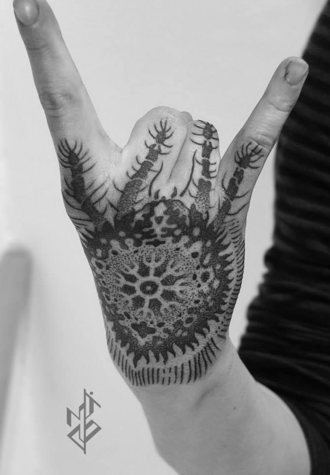 Wicked hand tattoo...