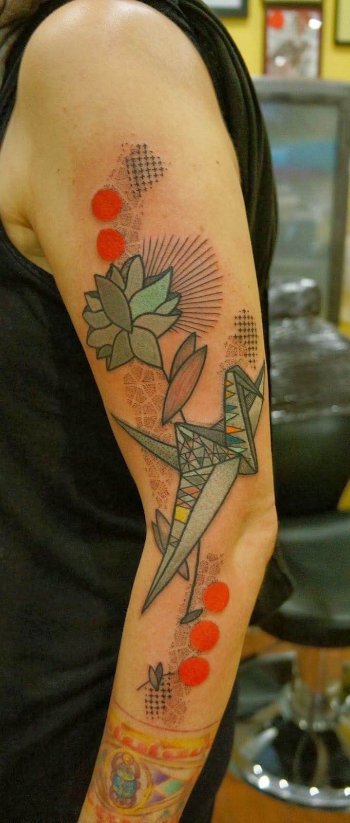 Gorgeous graphic tattoo by NOON!