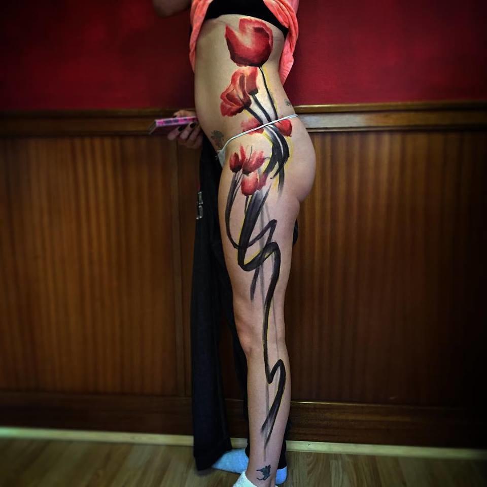 Poppy leg sleeve tattoo.