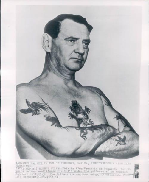 King Frederik XI displays his Naval tattoos