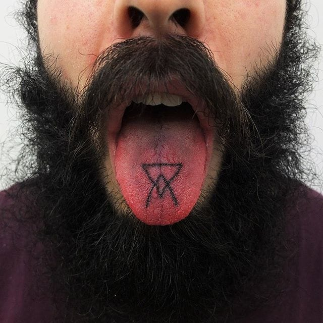 Simple tongue tattoo by Indy Voet