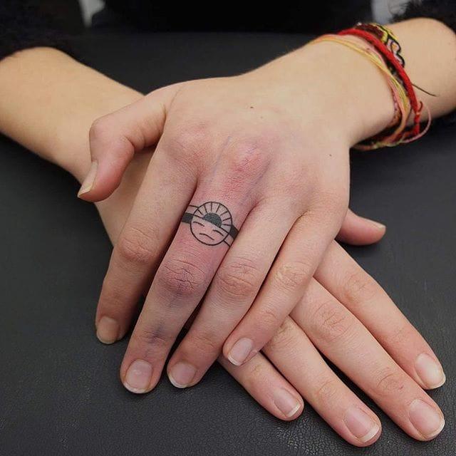 Minimalist ring tattoo