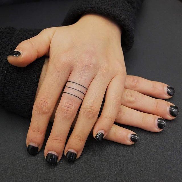 Crisp finger tattoos