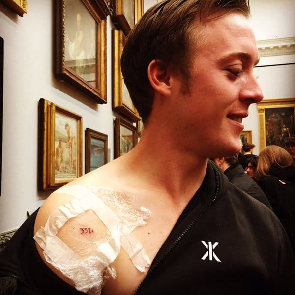 Protester after getting tattooed in the Tate Gallery photo from Liberate Tate
