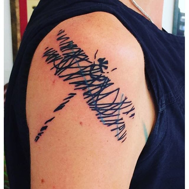 Dragonfly tattoo by Darwin Toucourt