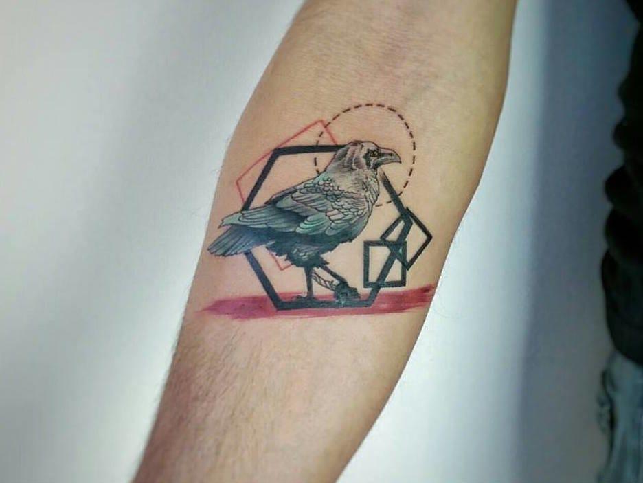 Geometric bird tattoo.