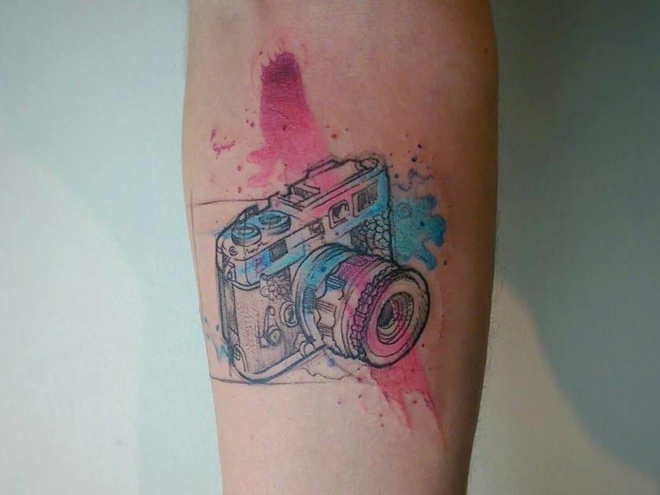 Watercolor camera tattoo.