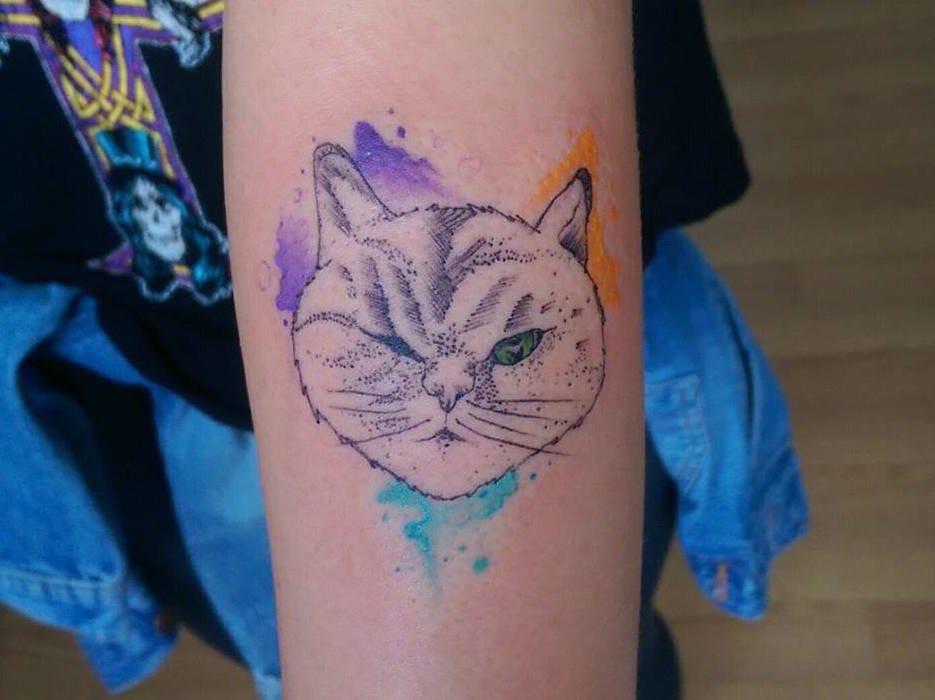 Watercolor cat tattoo by Baris Yesilbas.