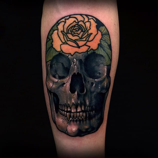 Realistic skull and classic rose tattoo by Varo
