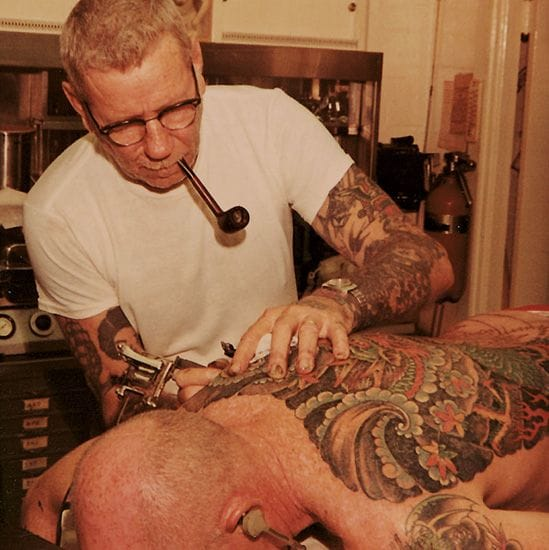 Sailor Jerry working on an amazing back tattoo