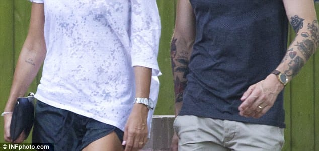 Close look on the matching tattoos