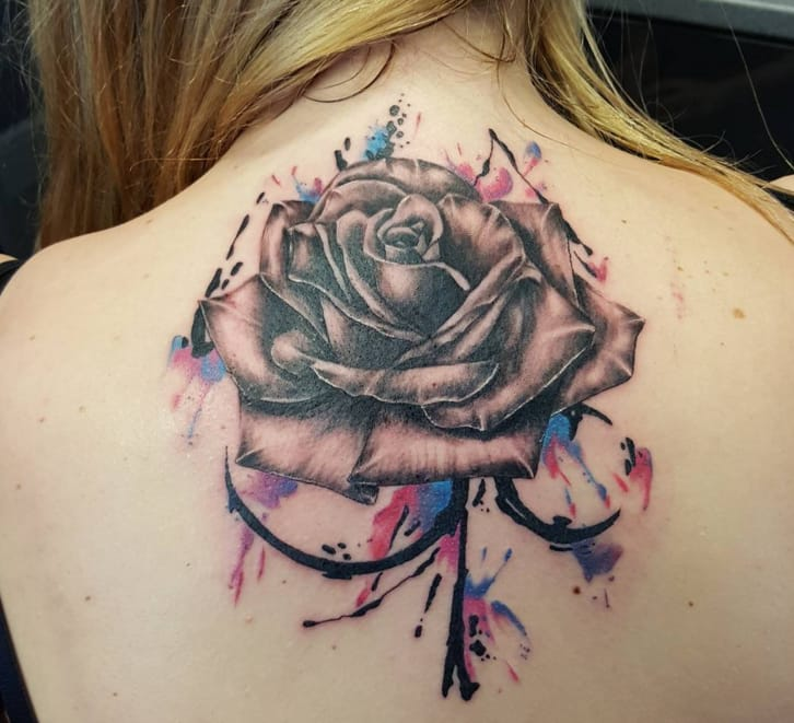 Rose tattoo by Tom Emmerson.