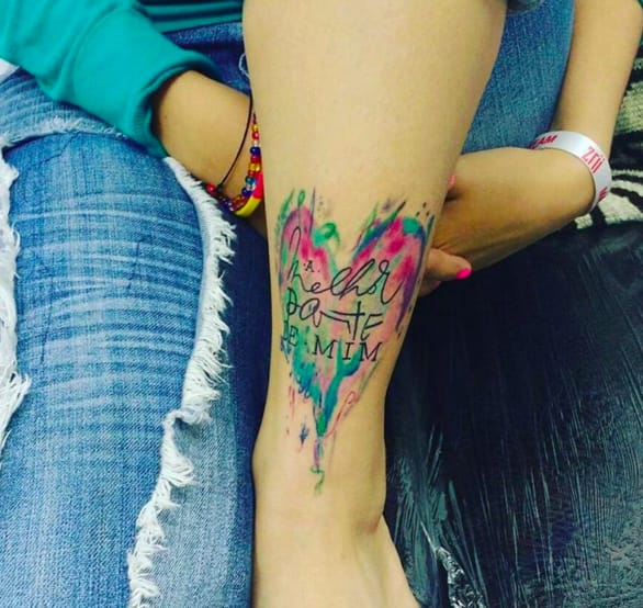 Color creates the outline of a heart in this tattoo from Instagram @indian_tattoo.