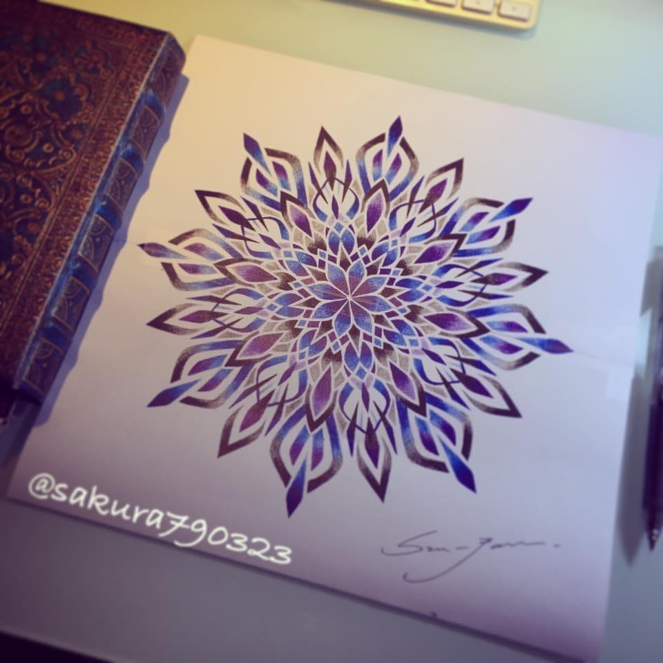 Mandala designs being drawn up.