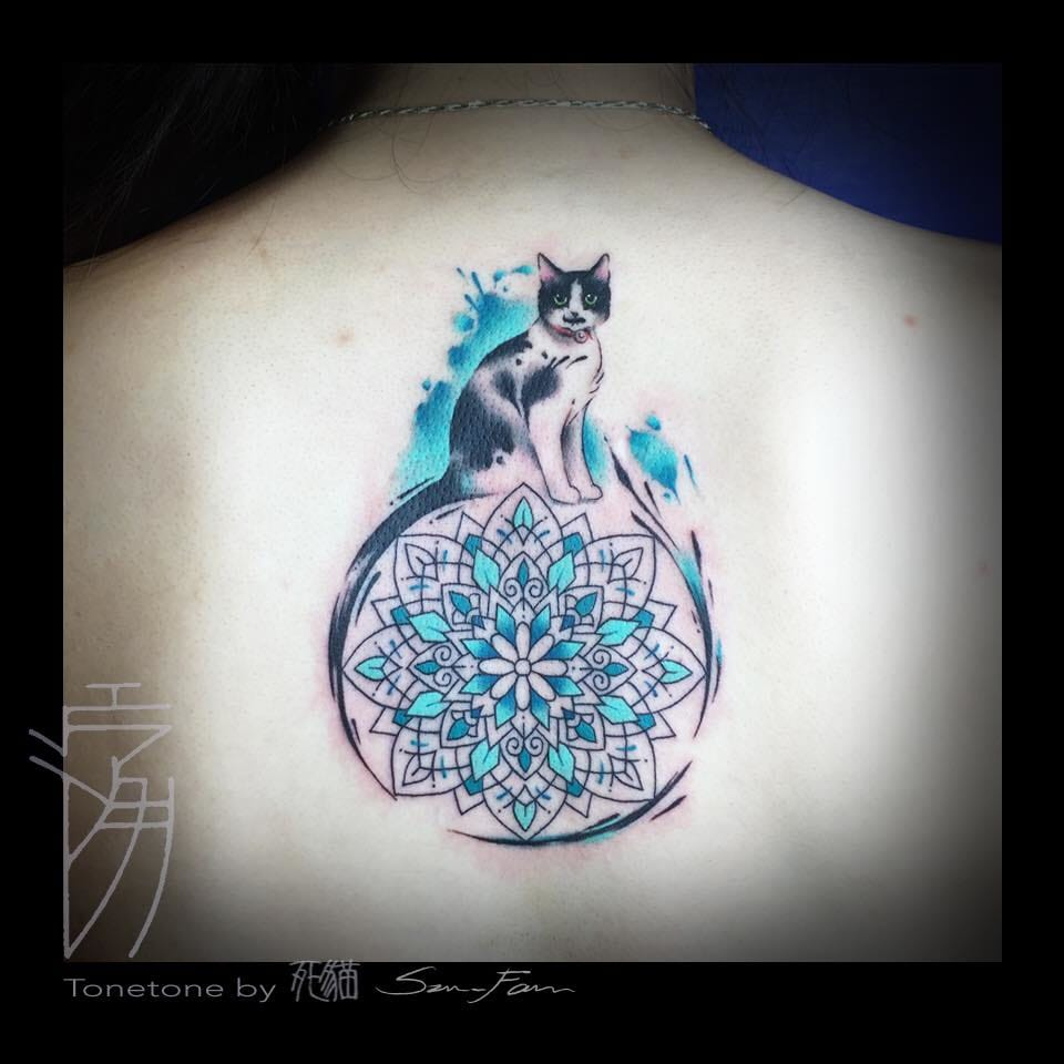 The cat's tail becomes the mandala's outline in this original tattoo.