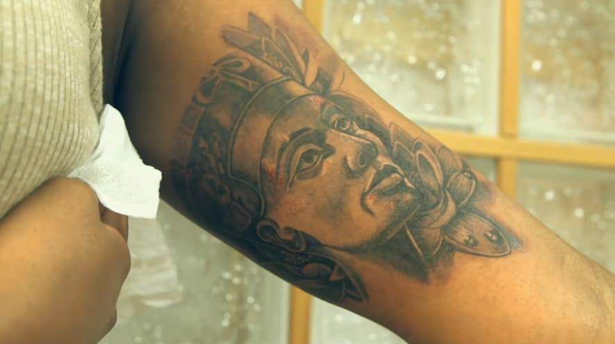 Black and grey Queen Nefertiti tattoo.