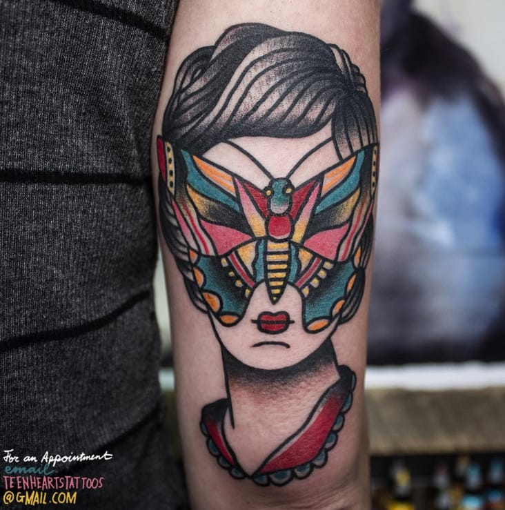 Moth and face tattoo by Teen Hearts Tattoo.