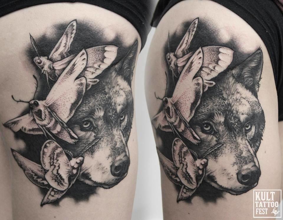 Pretty wolf tattoo.