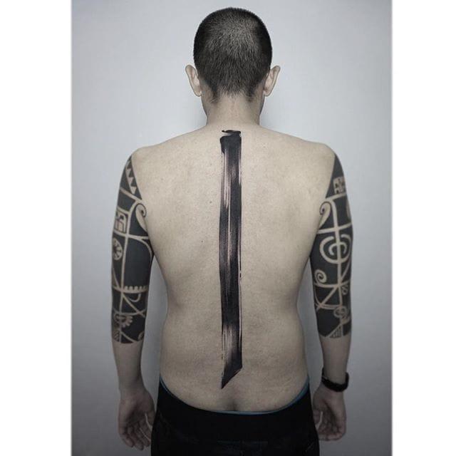 Bold spine tattoo.