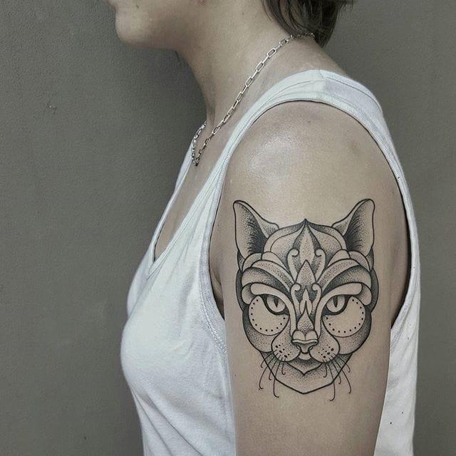 Fancy cat tattoo by Ben Doudakis.