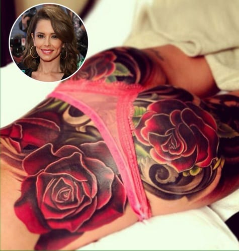 Cheryl Cole's huge flower piece from the middle of her back all the way to her upper thighs. via lifeandstylemag.com