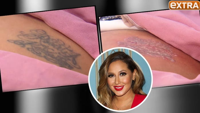 Adrienne Bailon had her ex's name ink on her bum, but had it removed on the show EXTRA
