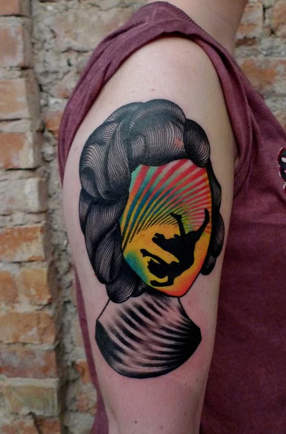 He knows how to combine black & bright colors, resulting to bright & bold tattoos.