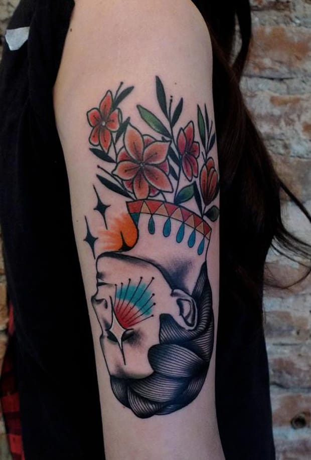 Quirky upside-down tattoo by Mariusz Trubisz.