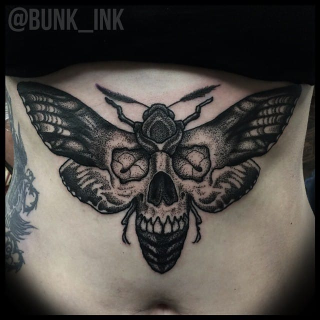 Bold black moth tattoo by @BUNK_INK