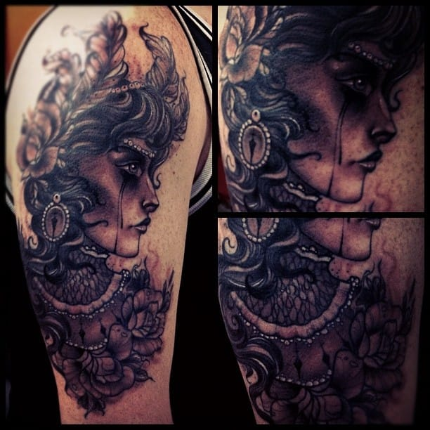 Cool detail on this girl head tattoo by Dean Kalcoff
