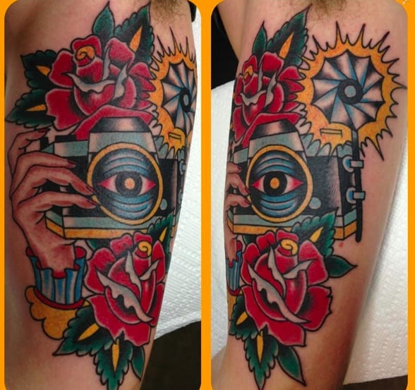 Clean and solid traditional camera tattoo. Artist unknown