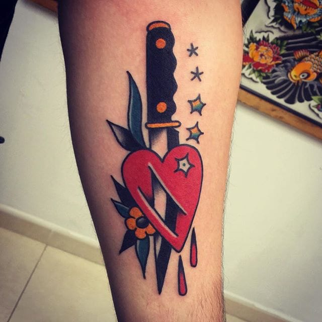 Knife through the heart tattoo by Christian Otto