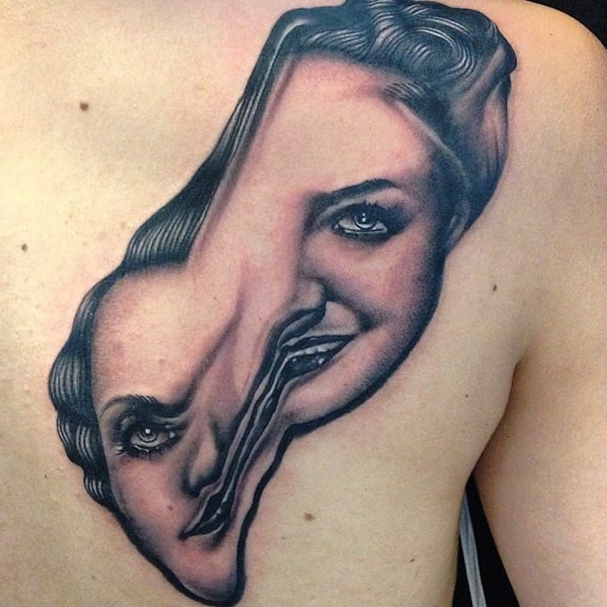 Warped woman face tattoo by Pietro Sedda