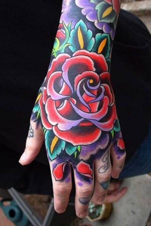 You can balance out the heaviness of the tattoo placement by selecting soft-looking tattoo imagery, such as the classic traditional roses. <3