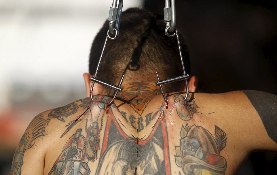 Hanging, Slicing, and Inking at Colombia's Cali Tattoo Festival