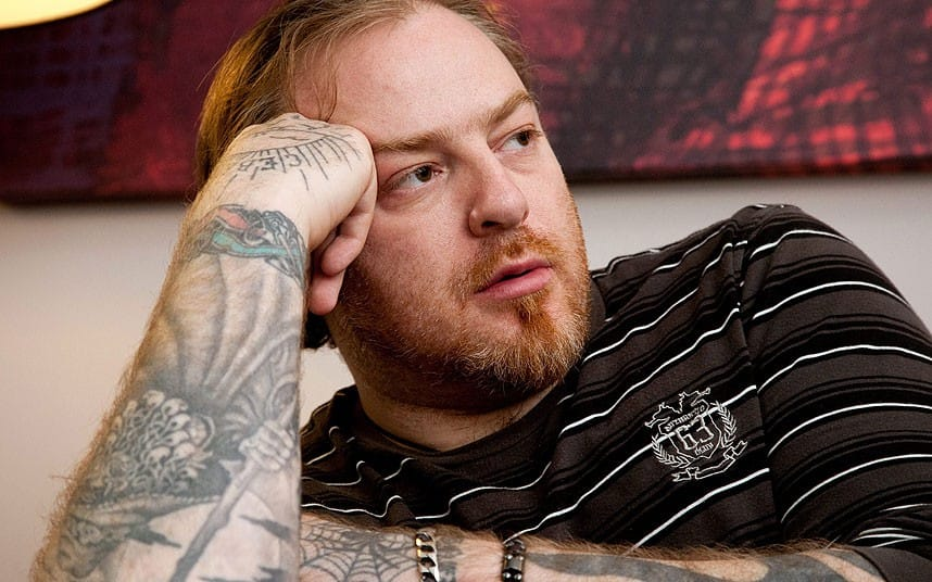Evgeny Nikitin is heavily tattooed all across his body many he got in his younger days