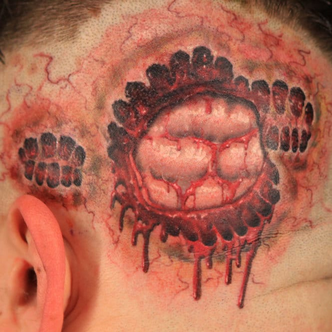 Zombie Bite Tattoo on the scalp by Kyle Dunbar.