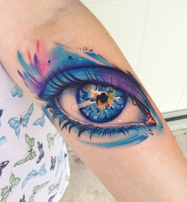 We're loving the cool shades of purple & blue! Beautiful tattoo by Mike Shultz.